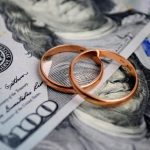 money and marital rings representing the work divorce attorney xenia does