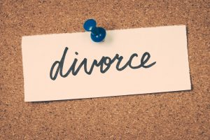 divorce on a bulletin board written in cursive for a trusted divorce lawyer
