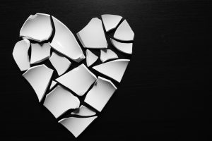Broken pieces of ceramic shaped in a heart and if you need a divorce call a top Dayton divorce attorney.